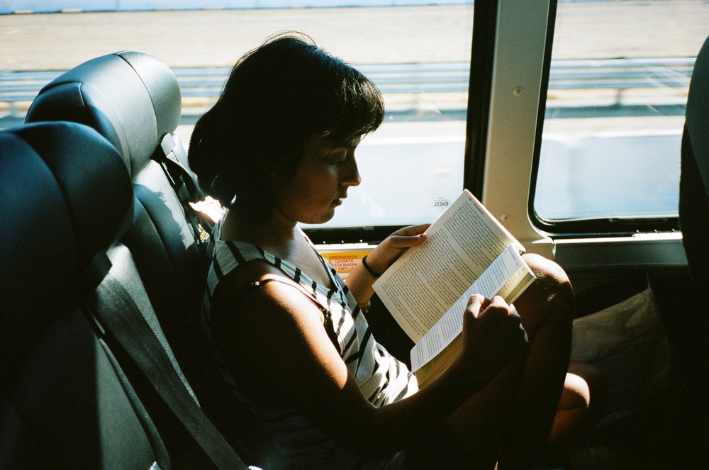 Sheila reading in Megabus, 2015