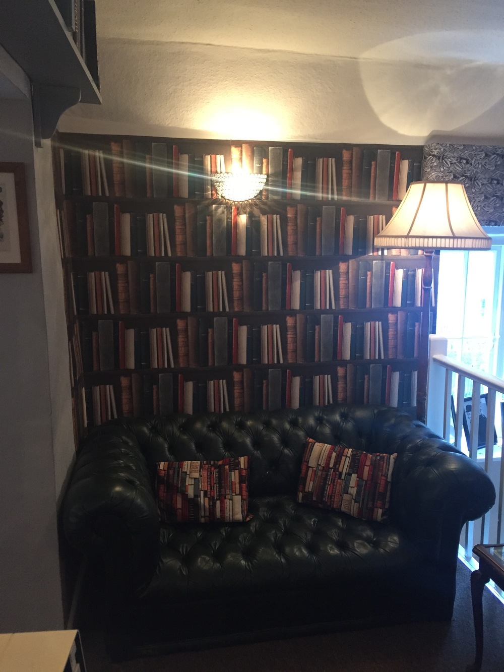 Cheddar Tea Rooms Decor: Library Wallpaper & Leather Chesterfield