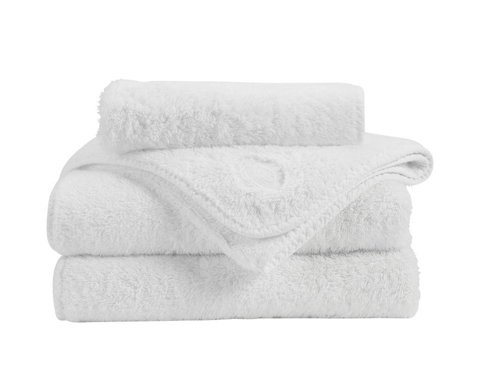 Bale of white towels from Christy Home
