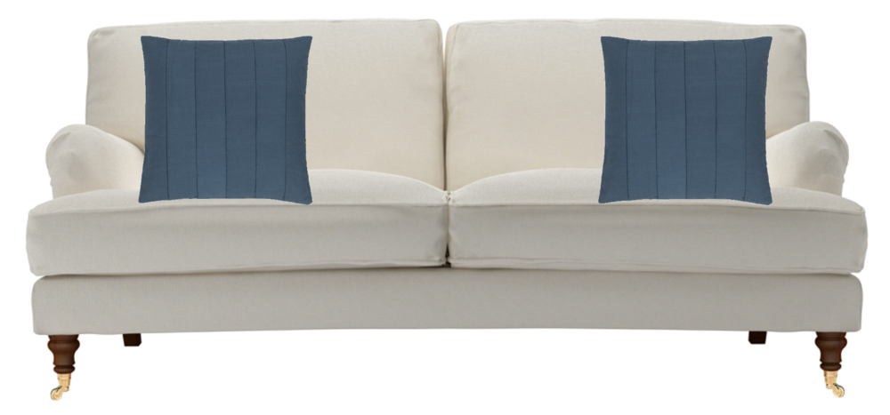 Two cushions or pillows arranged on a sofa