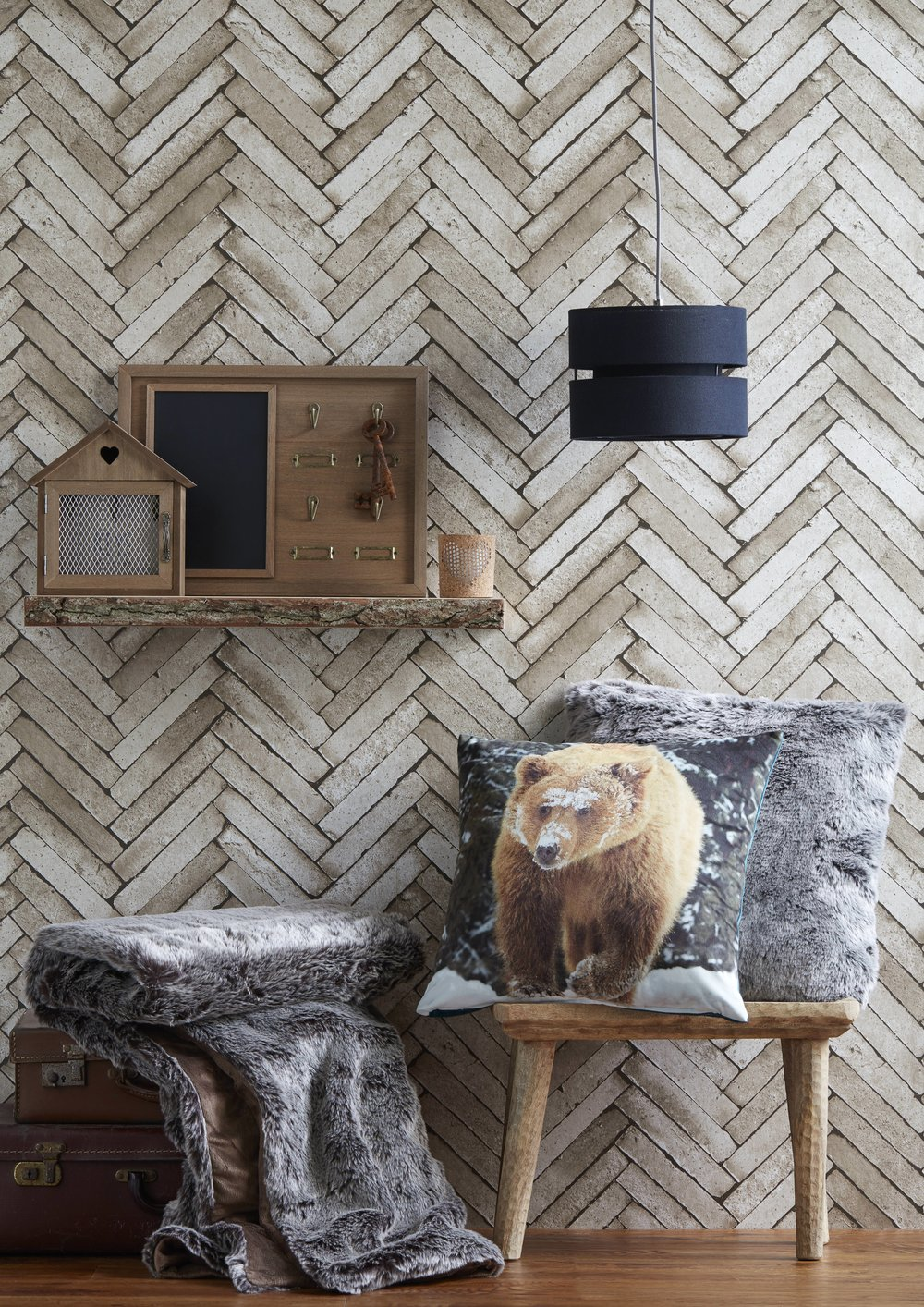 Herringbone patterned walls bring a strong textural element to the largest space in the room. Keep the rest of the decor simple to avoid overwhelm.  Image via B&Q