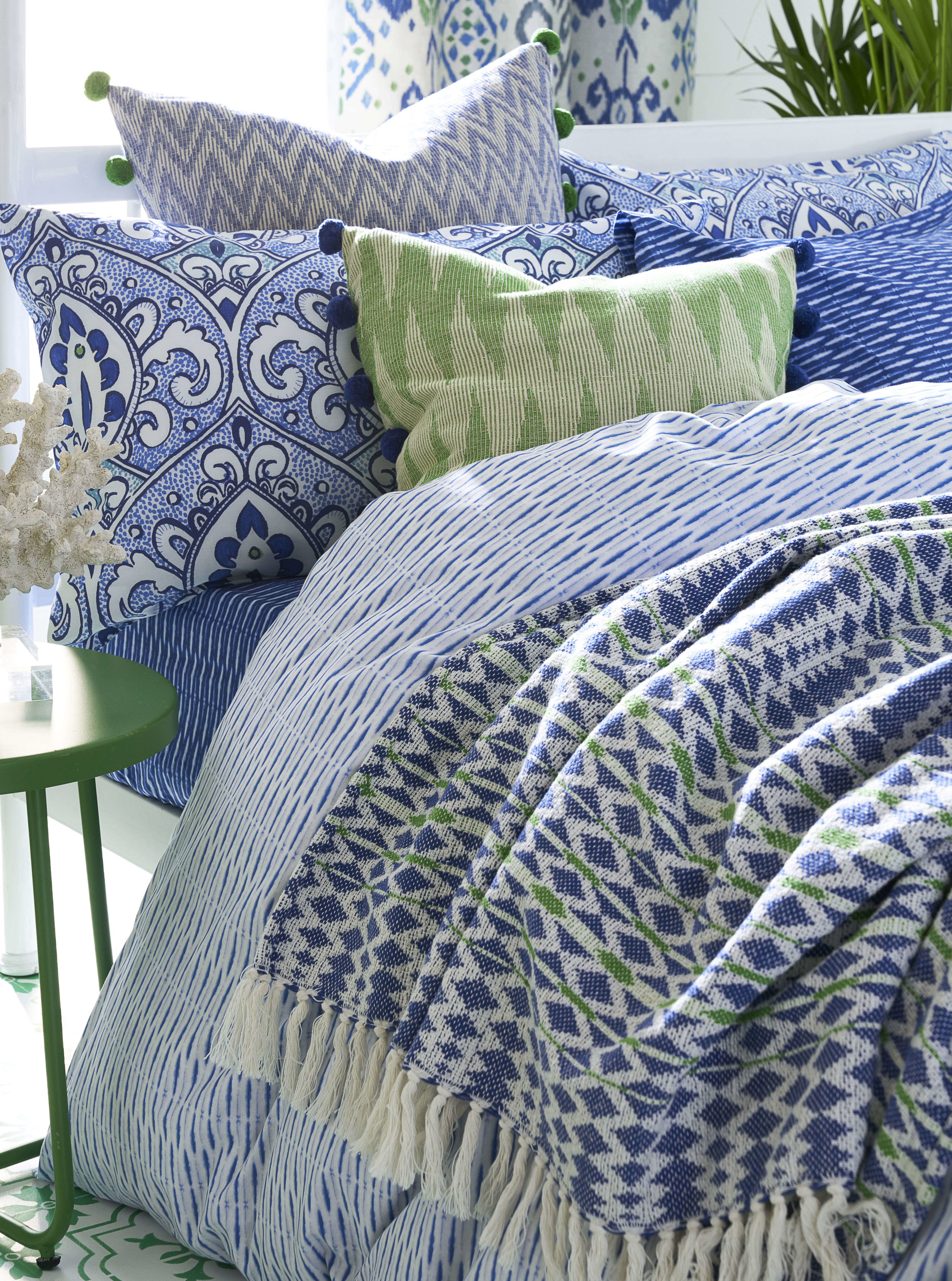 Layering textiles is a quick and easy way to bring a huge variety of texture into your home. Bed textiles from  Next .