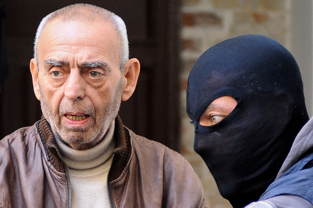 Mafia boss Salvatore Profeta is escorted by Italian police out of a police station to the jail in Palermo, Italy November 12, 2015. LAPRESSE/Guglielmo Mangiapane