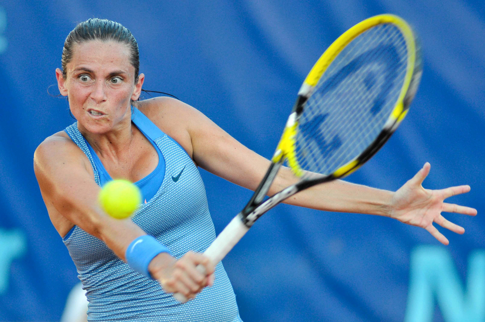 Italy's Roberta Vinci hits a shot during her match at the WTA XXVI Italiacom Tennis Open in Palermo.