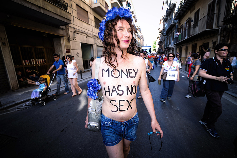 A participant walks down a road during the annual gay pride parade in Palermo, Italy June 27, 2015.