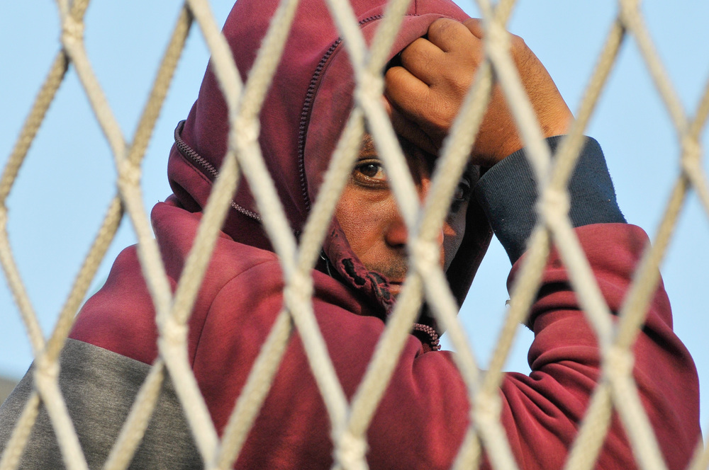 A migrant waits to disembark from the Italian navy ship Borsini in the Sicilian harbour of Palermo, Italy May 5, 2015. REUTERS/Guglielmo Mangiapane