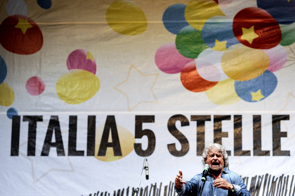 Leader of the 5-Star Movement Beppe Grillo gestures as he speaks during a meeting in Palermo, southern Italy, September 24, 2016. LAPRESSE/Guglielmo Mangiapane