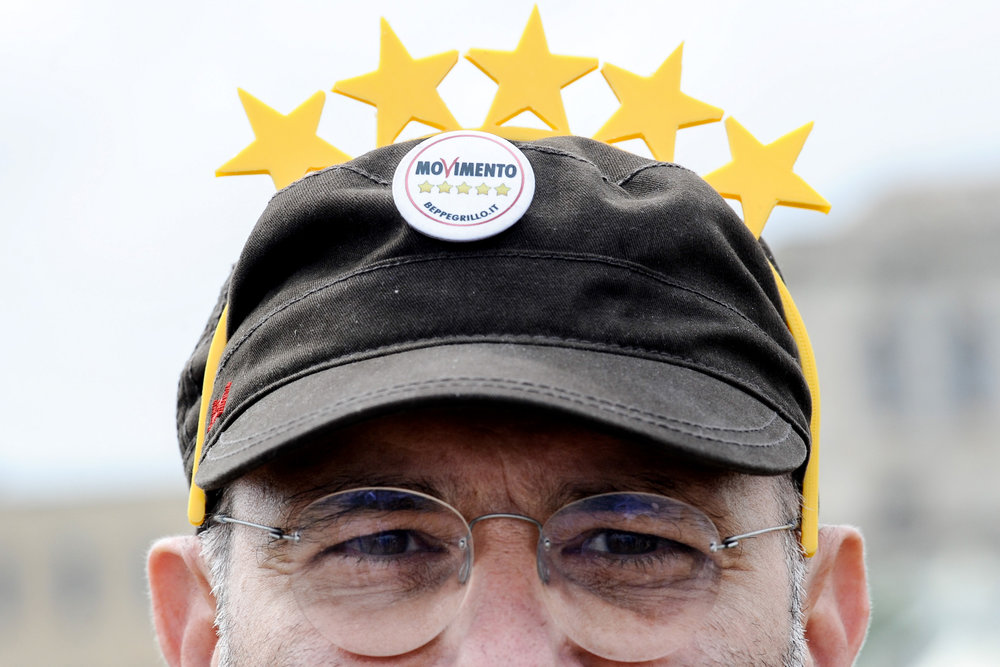 A 5-Star Movement supporter is pictured during a meeting in Palermo, southern Italy, September 25, 2016. LAPRESSE/Guglielmo Mangiapane