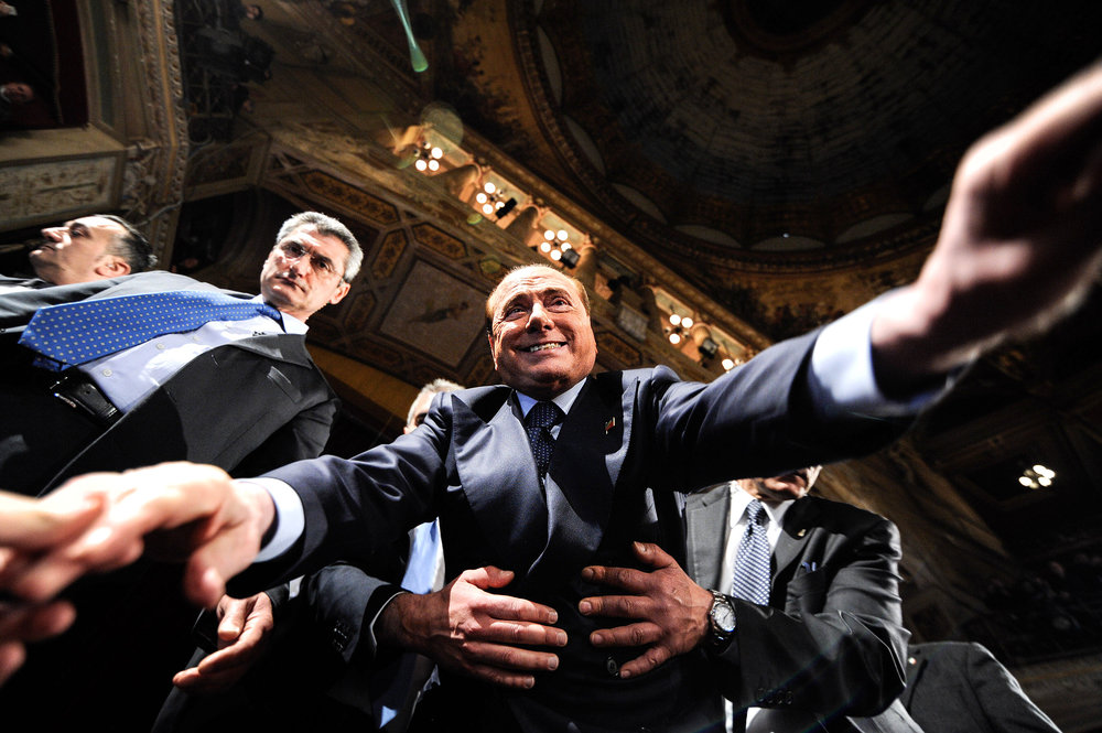 Forza Italia party leader Silvio Berlusconi greets supporters after a rally in Palermo, Italy March 19, 2016.