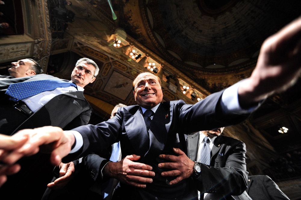Forza Italia party leader Silvio Berlusconi greets supporters after a rally in Palermo, Italy March 19, 2016. LAPRESSE/Guglielmo Mangiapane