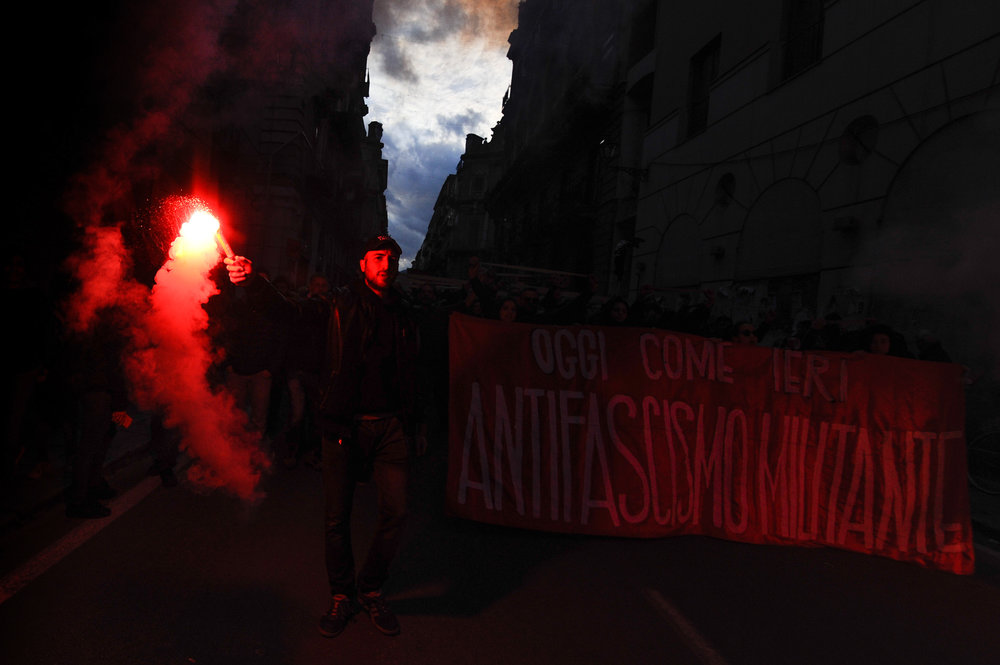 Demonstrators march lighting flares during an anti-fascism demonstration in Palermo, Italy, February 24, 2018.