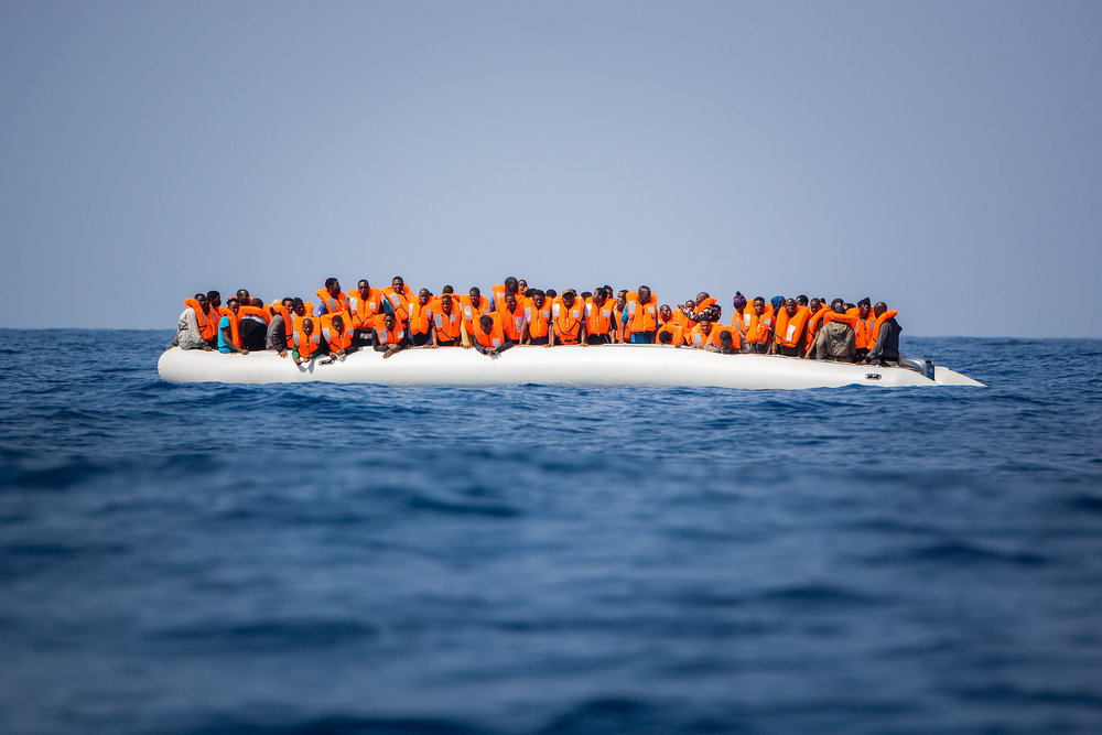 Migrants on a rubber boat are rescued by the SOS Mediterranee organisation and Doctors without borders during a search and rescue operation in the Mediterranean Sea, off the Libyan Coast, May 31, 2018.