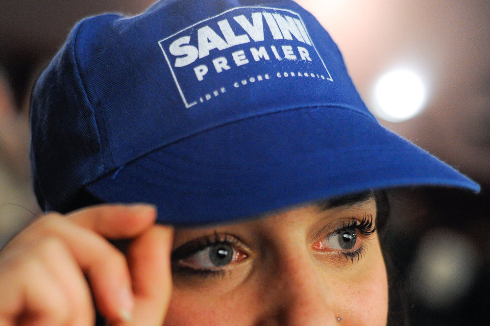 A supporter of Matteo Salvini looks on as Northern League's leader speaks during an electoral rally in Palermo, Italy February 14, 2018.