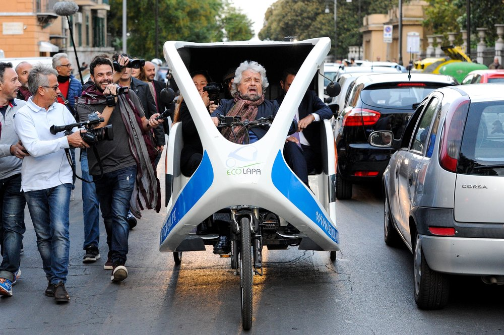 Founder of 5-Star movement Beppe Grillo rides an eco lapa car during a rally for the regional election in Palermo, Italy, October 29, 2017.