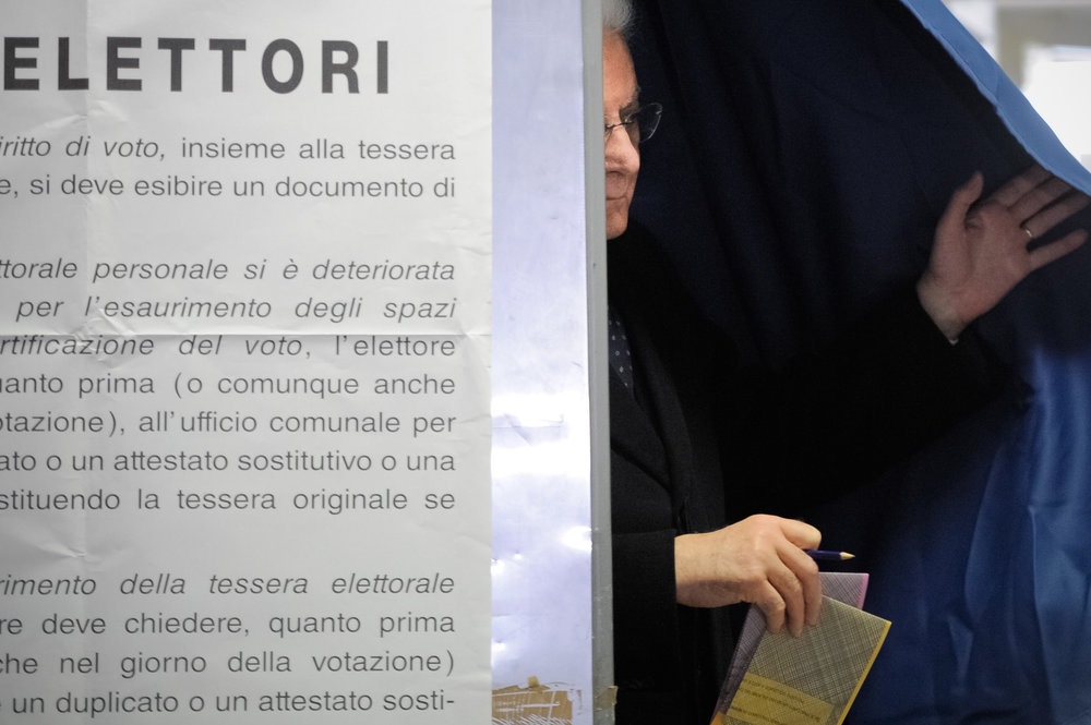 Italian President Sergio Mattarella casts his vote at a polling station in Palermo, Italy, March 4, 2018.