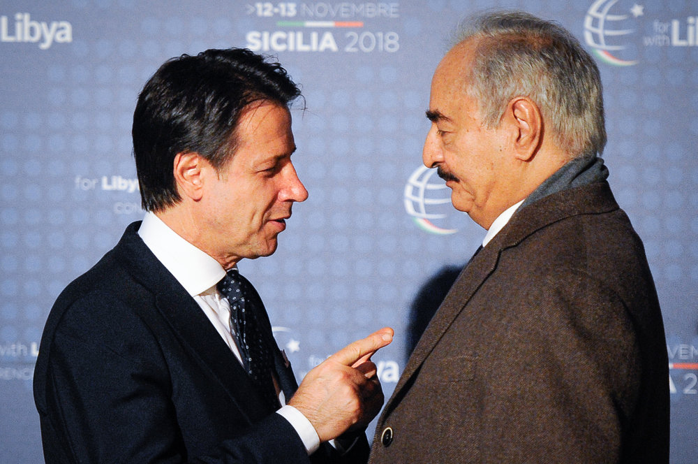 Italy's Prime Minister Giuseppe Conte welcomes Libyan military commander Khalifa Haftar as he arrives at the venue of the international conference on Libya in Palermo, Italy, November 12, 2018.