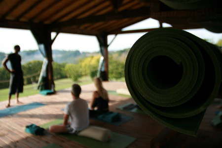 Yoga class at the retreat with students with excellent views