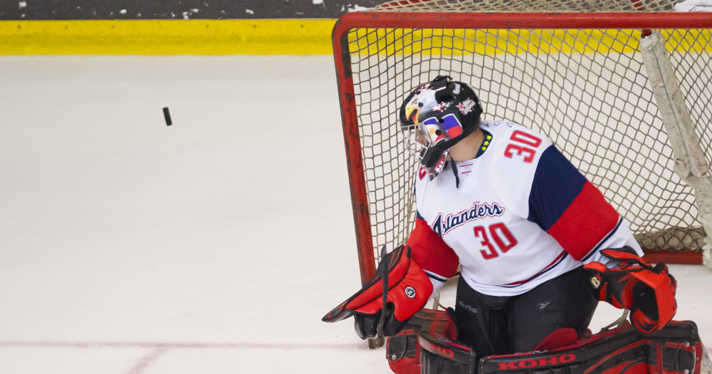 A Filipino goal keeper stares at an approaching puck during the Lion City Cup at the Rink.
