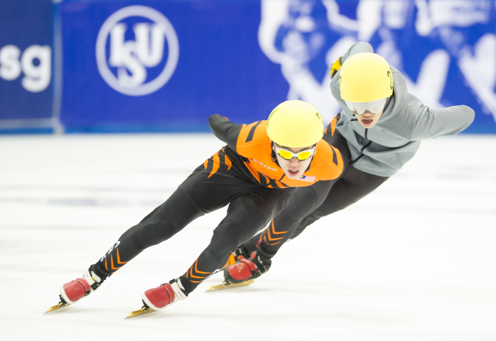Two Malaysian speed skaters edge on the ice during the Tri-series SEA cup at the Rink.