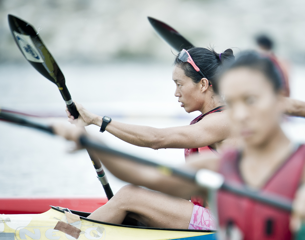 A kayaker overtakes another during training at the Marina Channel.