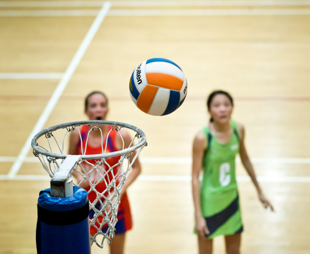 Netballers watch as a ball approaches the net during a Netball Super League match at the Toa Payoh Sports Hall.