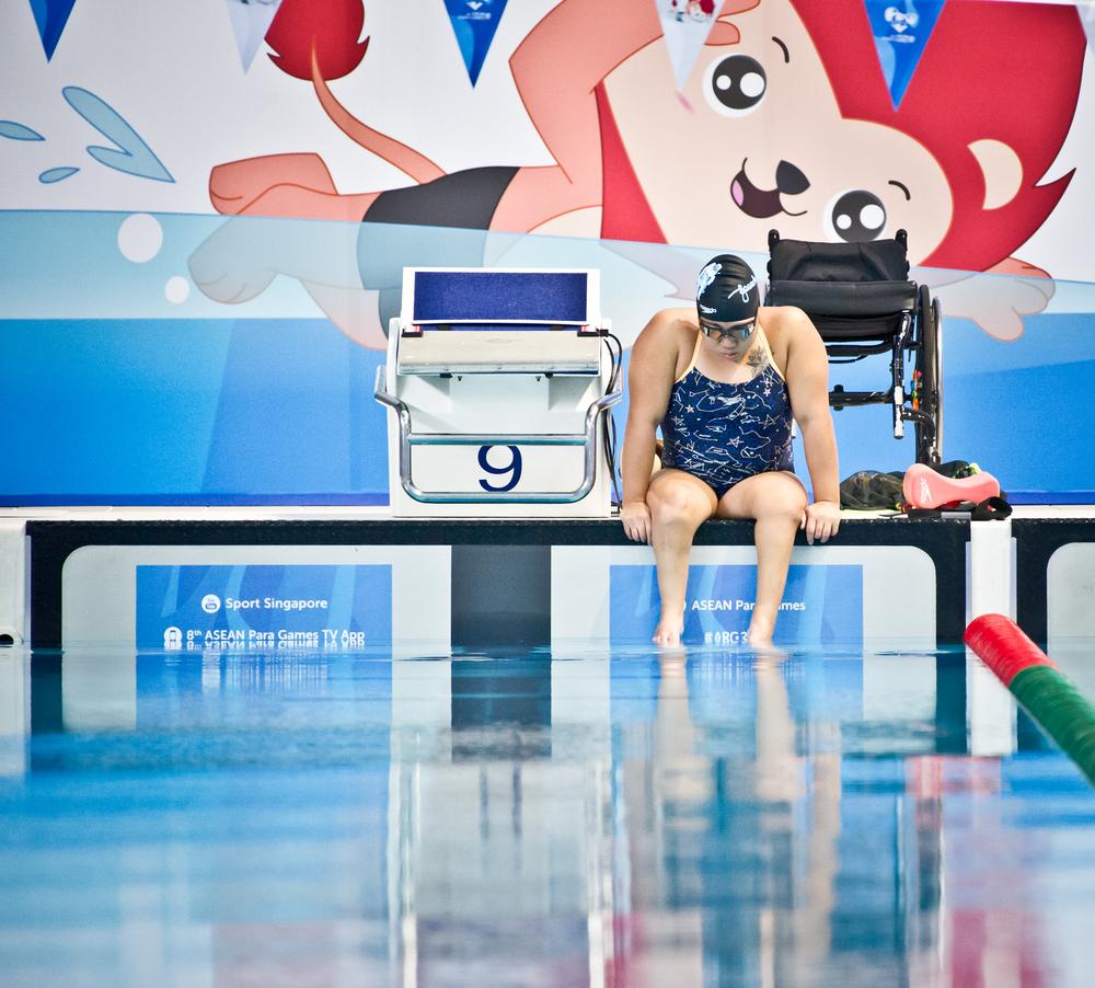 A para-swimmer stares at the water during warm up at the ASEAN Para Games at the OCBC Aquatic Centre.