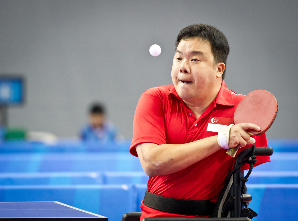A para-table tennis player prepares to return the ball during the ASEAN Para Games at the OCBC Arena.