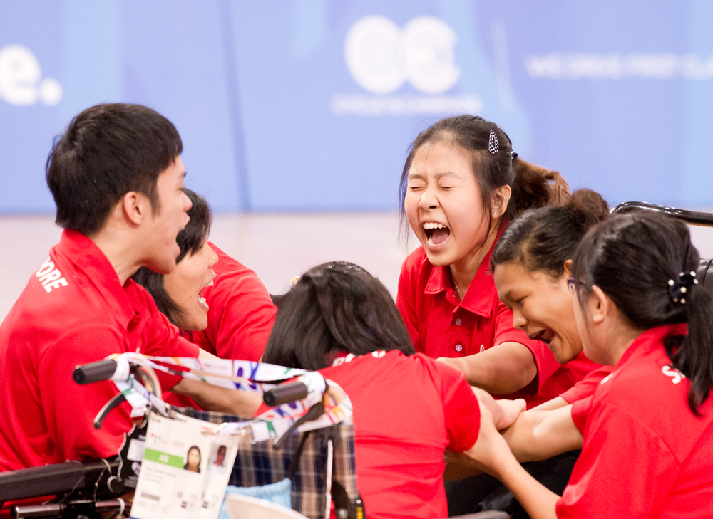 Boccia players prepare to cheer during the ASEAN Para Games at the OCBC Arena.