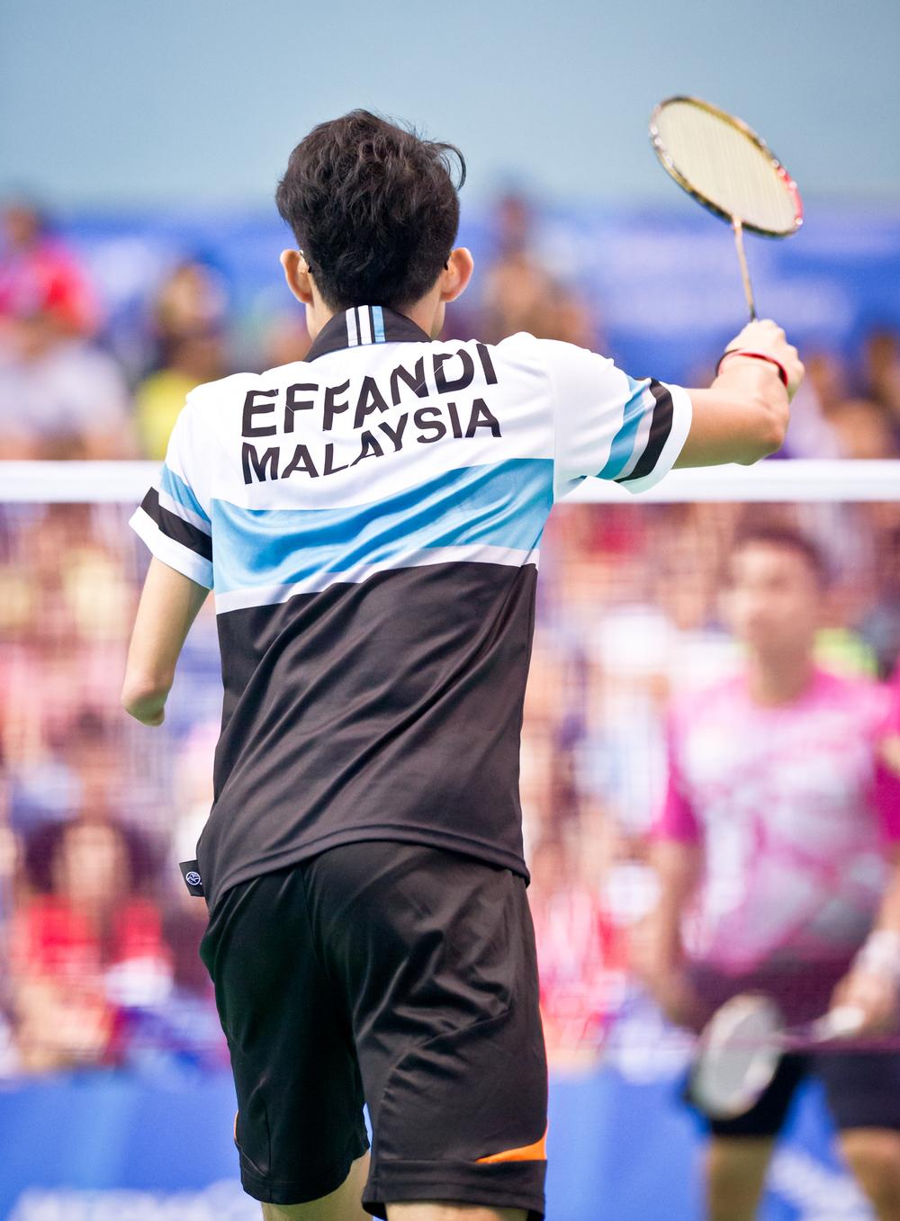 A Malaysian para-badminton player prepares to receive a serve during the ASEAN Para Games at the OCBC Arena.