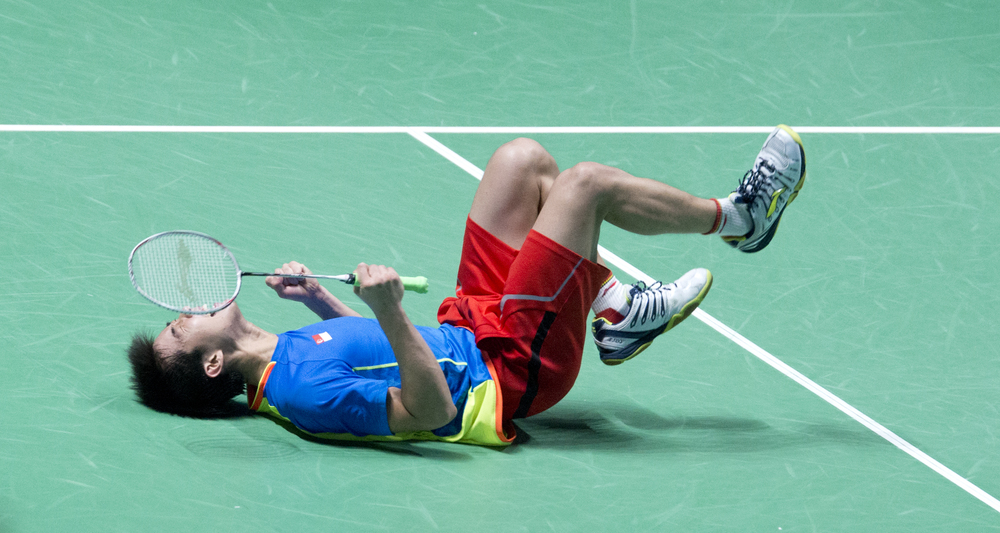 A Singaporean badminton player celebrating during the SEA Games at the Singapore Indoor Stadium.