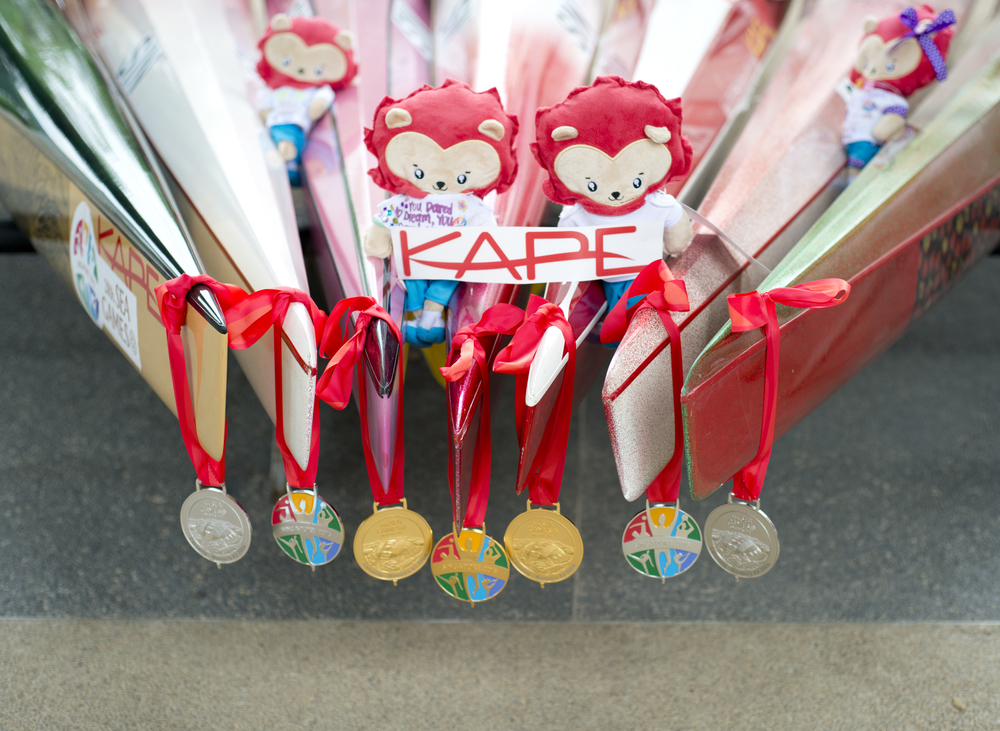 Canoeing medals hang on the bow of canoes during the SEA Games at the Marina Channel.
