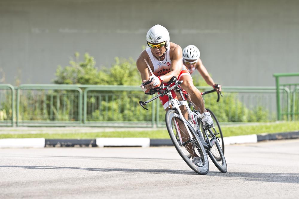 A triathlete edges during training at Seletar Air Base.