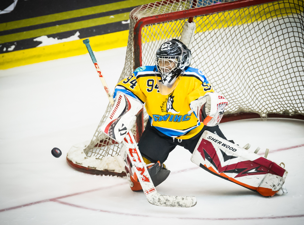 The Singapore Women's Ice Hockey Club goal keeper stares at an approaching puck during the Lion City Cup at the Rink.