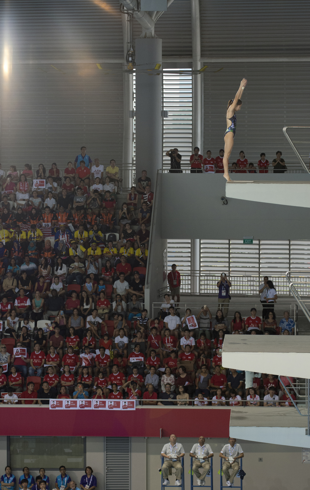A diver prepares to take the plunge during the 10m diving finals of the SEA Games at the OCBC Aquatic Centre.