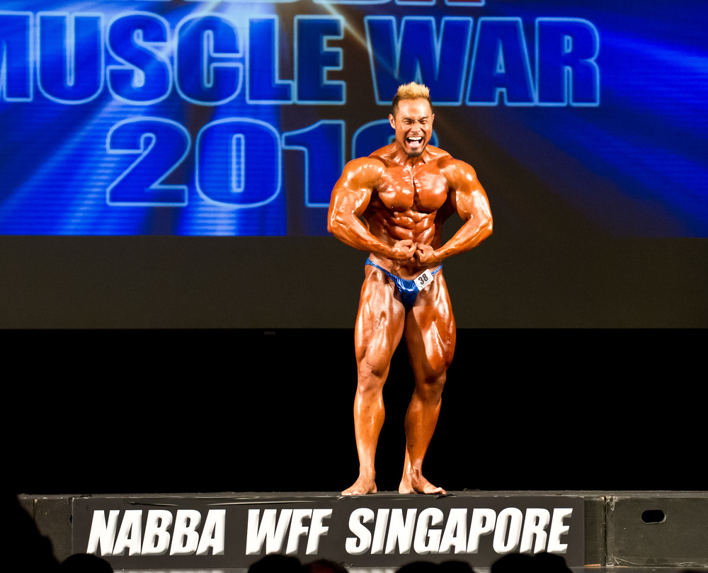 A body builder flexes during the NABBA Muscle War competition at Scape.