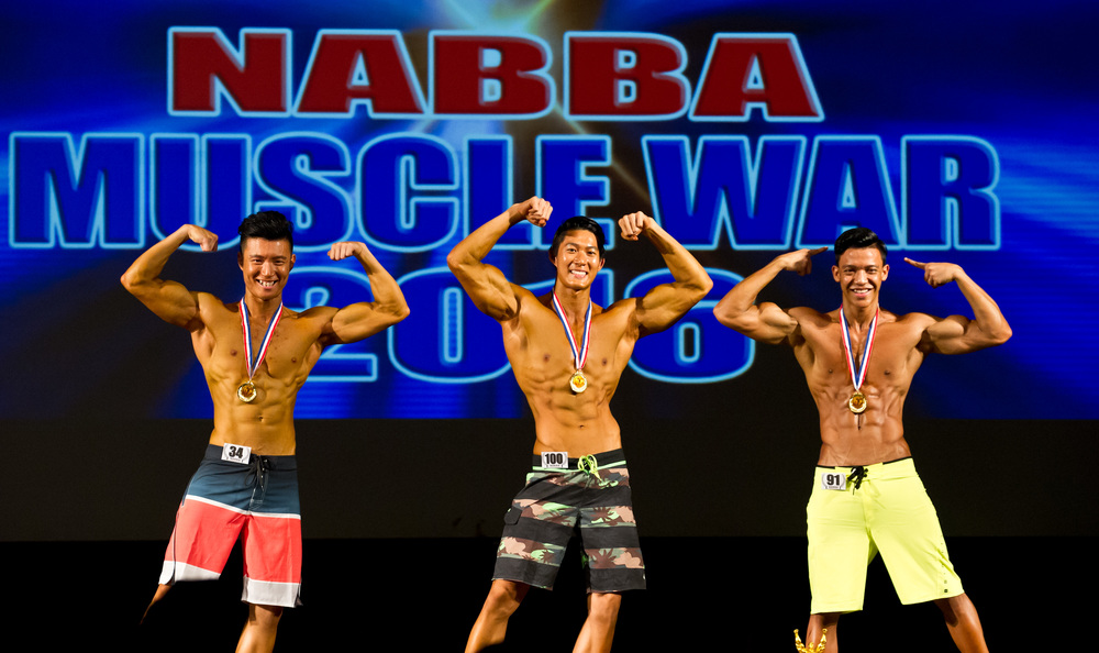 Winners of the fitness category pose with their medals during the NABBA Muscle War competition at Scape.
