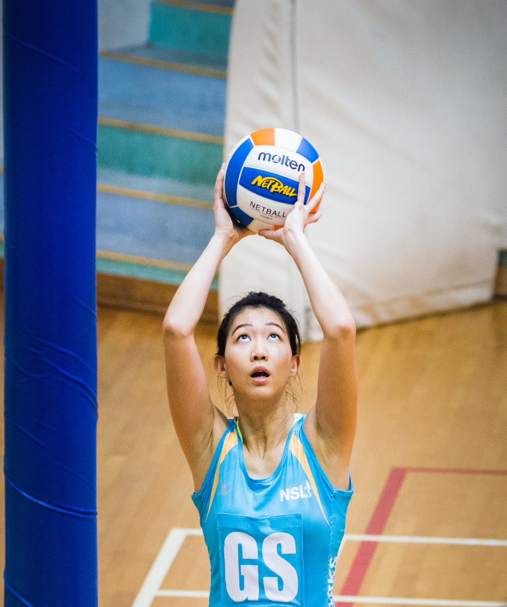 A netballer prepares to score during a Netball Super League match at the Toa Payoh Sports Hall.