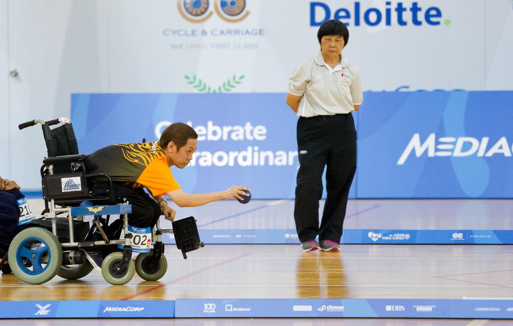 A Malaysian boccia player takes aim during the ASEAN Para Games at the OCBC Arena.