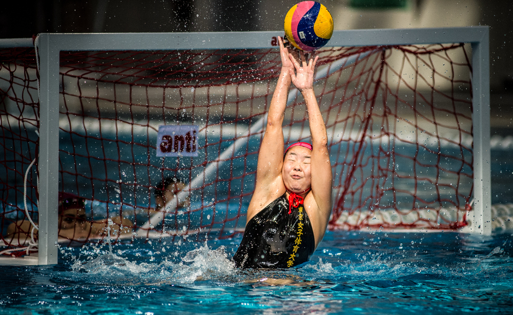 A Japanese goal keeper blocks an attempt at goal during a friendly at the OCBC Aquatic Centre.