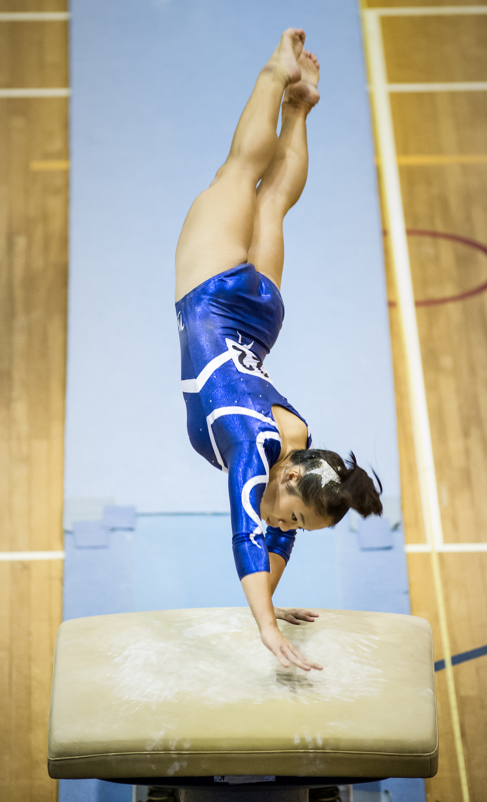 A gymnast does a vault during the National Schools Championships at the Bishan Sports Hall.