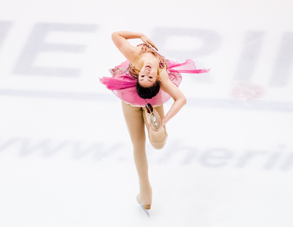 A Singaporean figure skater executes a spin during the Singapore National Championships at the Rink.