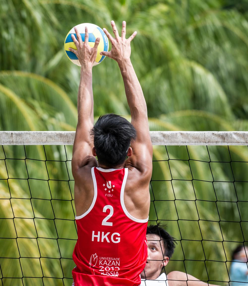 A Hong Kong player blocks a shot during the Beach Volleyball National Series at the Yio Chu Kang Swimming Complex.