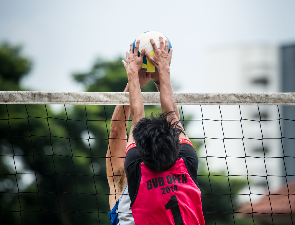 A Hong Kong player prepares to block a spike during the Beach Volleyball National Series at the Yio Chu Kang Swimming Complex.