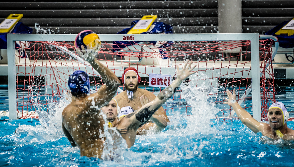 A Greek player prepares to score against Australia during the Greece vs Australia pre-Olympic sparring match at the OCBC Aquatic Centre.