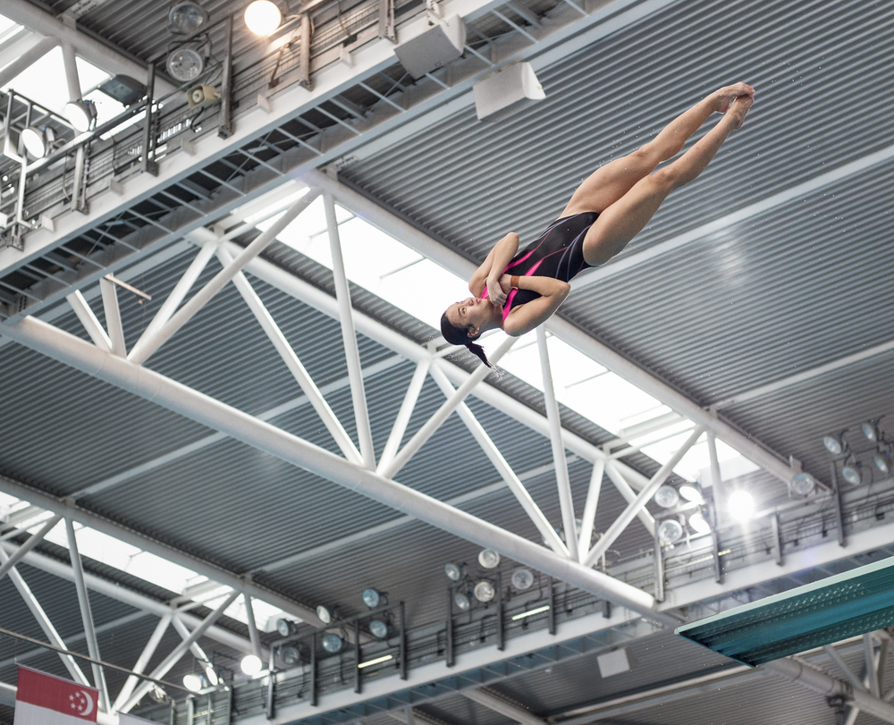 A Singaporean diver rotates in the air during the Singapore National Diving Championships at the OCBC Aquatic Centre.