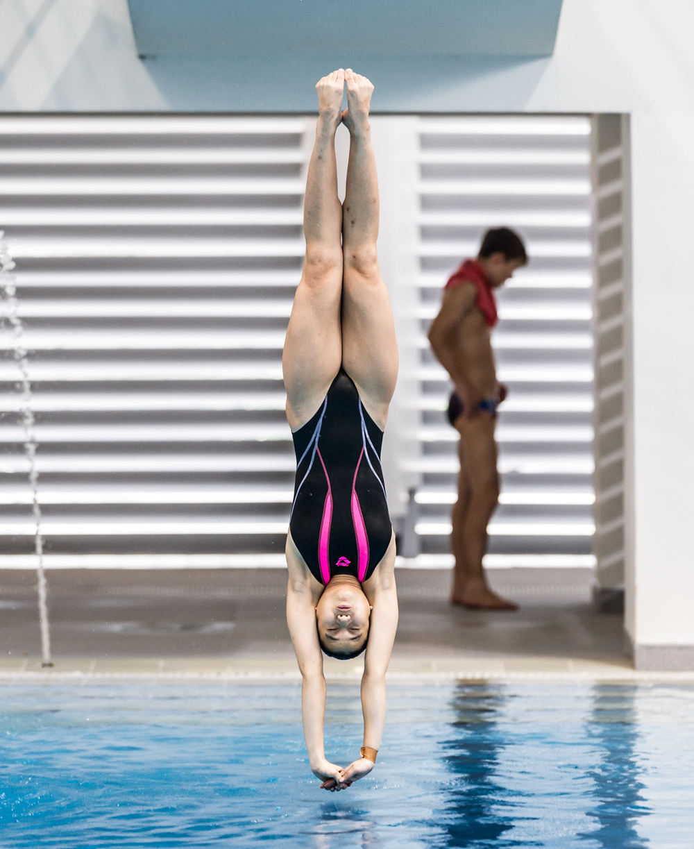 A Singaporean diver prepares to enter the water during the Singapore National Diving Championships at the OCBC Aquatic Centre.