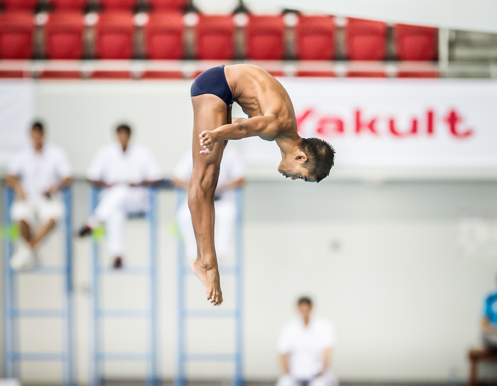 A Malaysian Diver rotates in the air during the Singapore National Diving Championships at the OCBC Aquatic Centre.