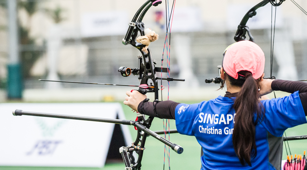 An arrow leaves the bow or an archer during the archery competition of the ASEAN University Games at the National Institute of Education.