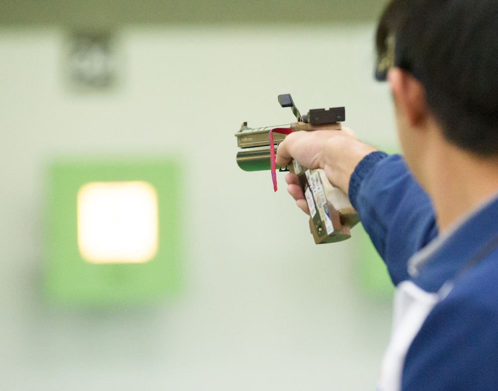 A Thai shooter takes aim during the shooting competition of the ASEAN University Games at Yishun SAFRA.