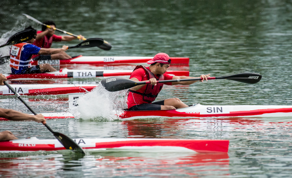 A Singaporean paddler takes an early lead in the Canoeing competition of the ASEAN University Games at the Marina Channel.